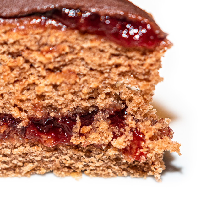 """""""Detail of slice of chocolate cake with strawberry jam filling"""" stock image"""
