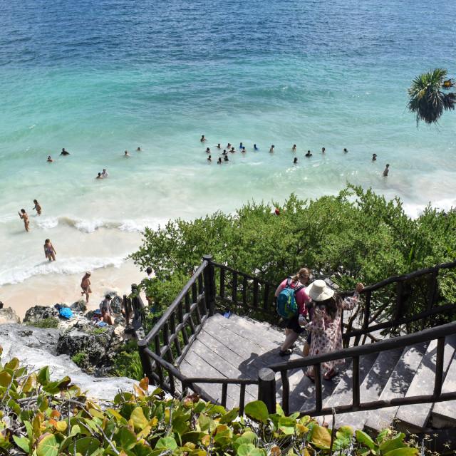 """Swimming at Tulum's Mayan ruins"" stock image"