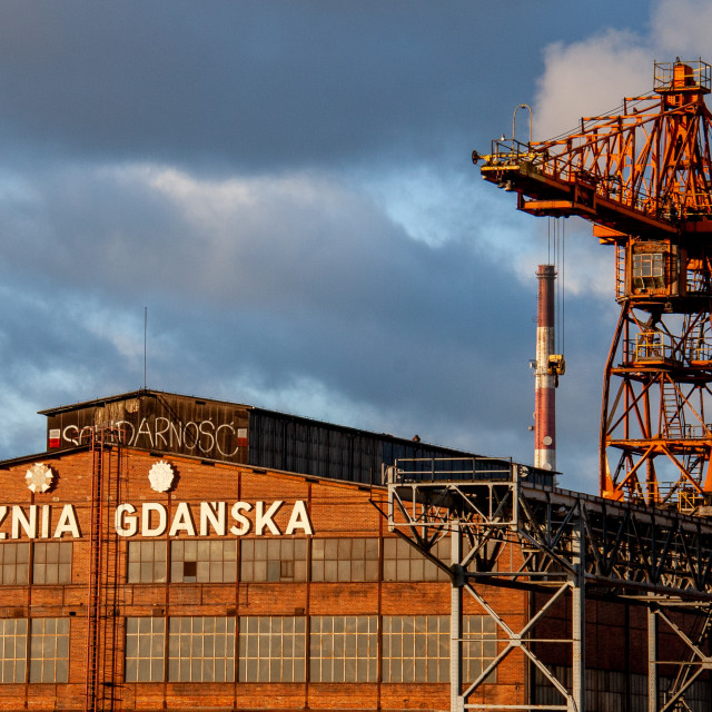 """Gdansk, Poland, Steelworks crane and Stocznia works building.."" stock image"