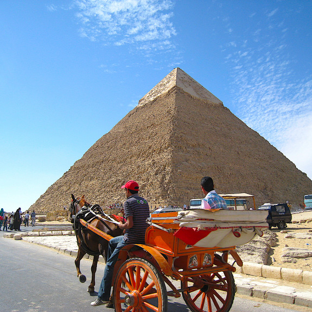 """Horse-drawn sleigh by Giza pyramids"" stock image"