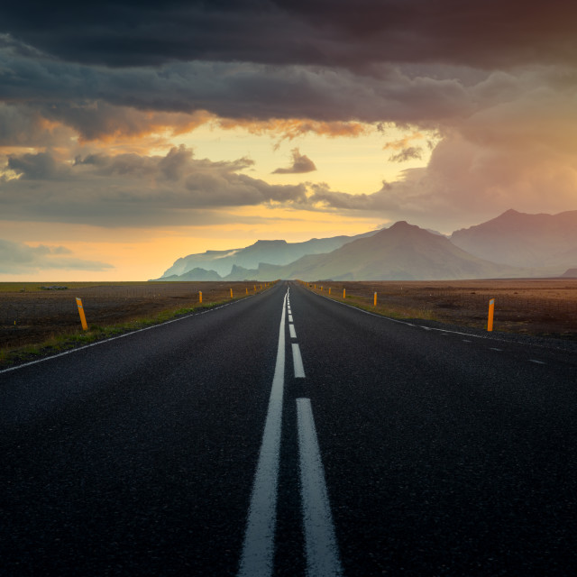 """Typical icelandic landscape with empty road and scenic nature"" stock image"
