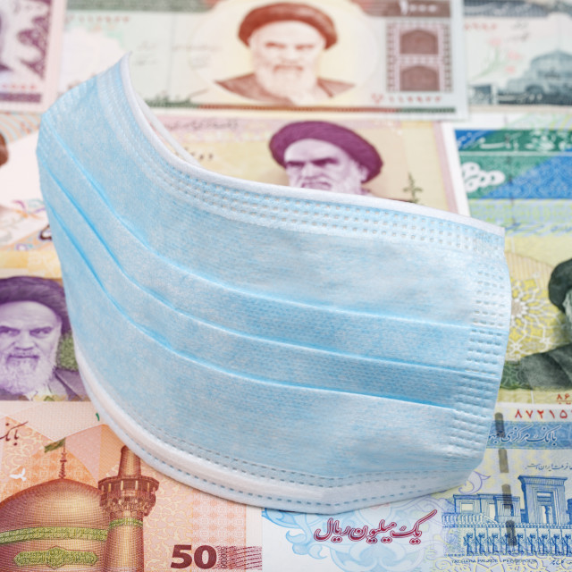 """Protective mask on a Iranian money"" stock image"