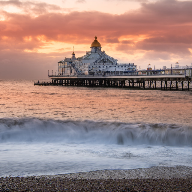 """Sunrise, Eastbourne Pier, Sussex, England"" stock image"