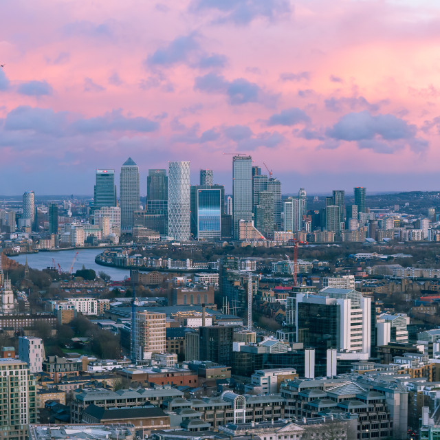 """Aerial sunset cityscape of River Thames with Canary Wharf in the"" stock image"