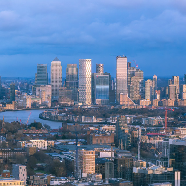 """Aerial cityscape of River Thames with Canary Wharf in the backgr"" stock image"