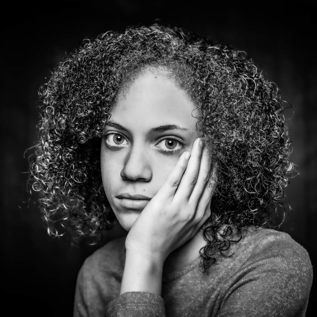 """Black and White Sad Young Woman"" stock image"