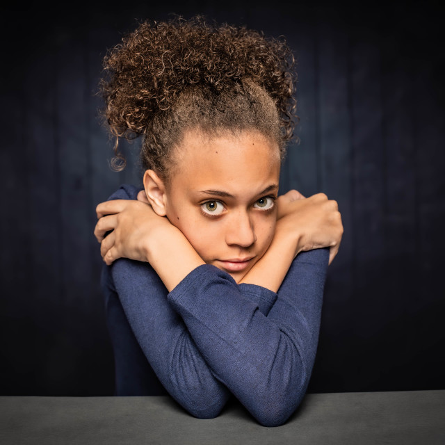 """Pretty Young Girl with Arms Crossed"" stock image"