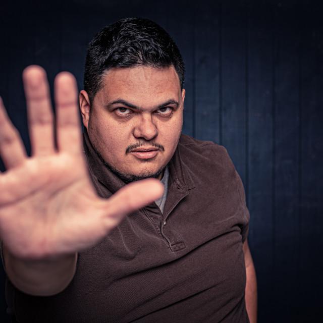 """Latino Man Gesturing Stop"" stock image"