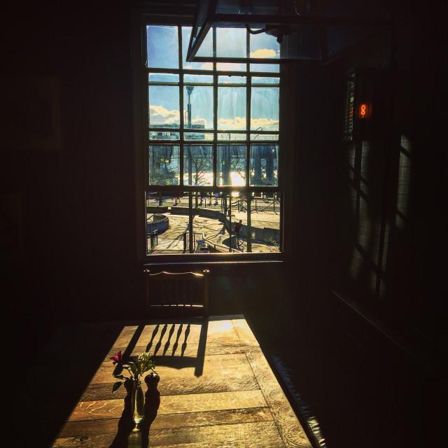 """Sun through window on the Thames"" stock image"