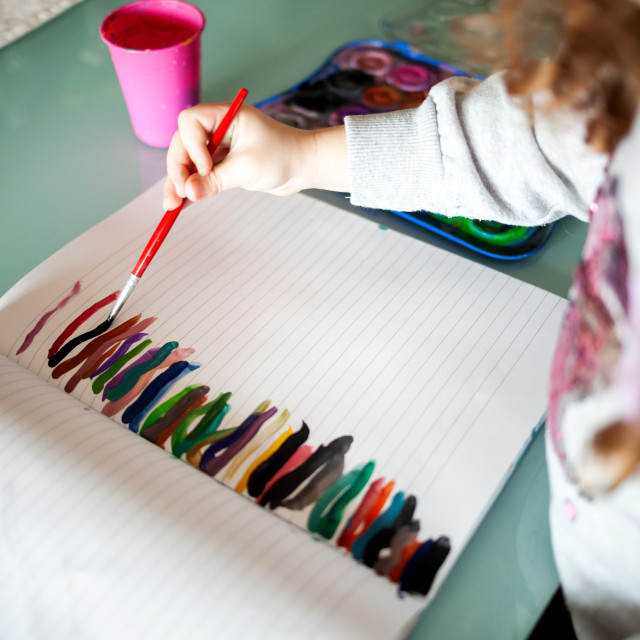 """Hands of little girl painting with watercolors at home. Learn, education,..."" stock image"