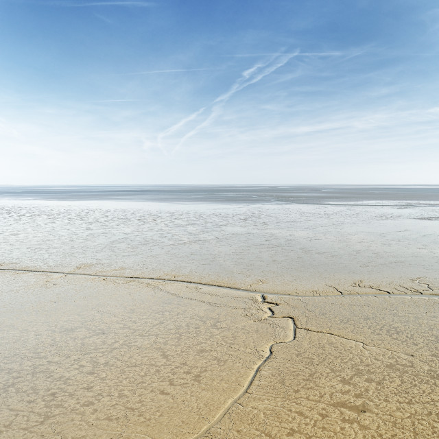 """""""North Sea view over a wide mudflat area at low tide"""" stock image"""