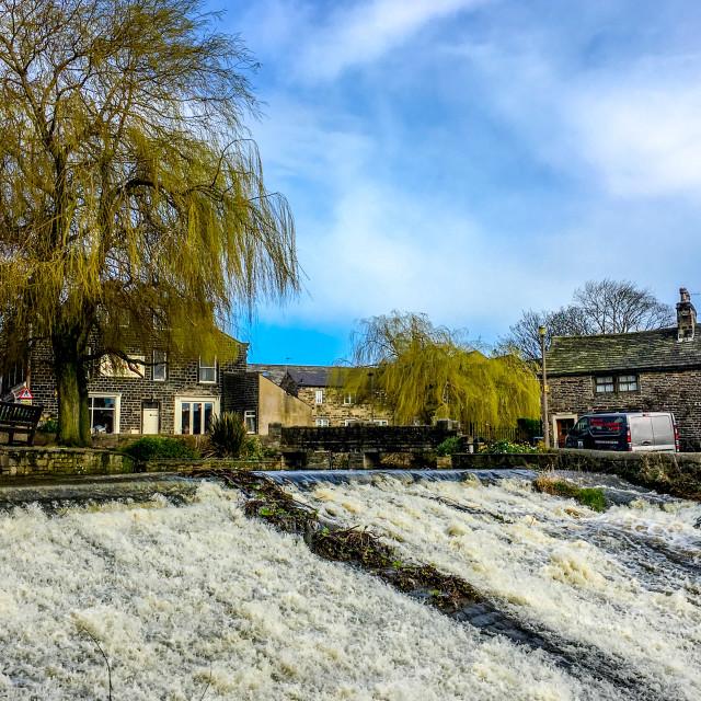 """Silsden Beck Cascading over the Weir in Silsden ,(Cobbydale) West Yorkshire"" stock image"