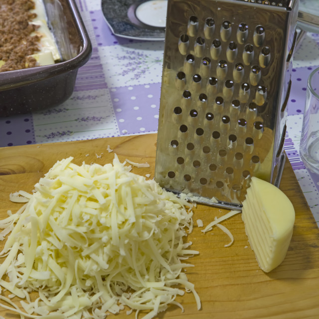 """""""Grated hard cheese in the kitchen"""" stock image"""