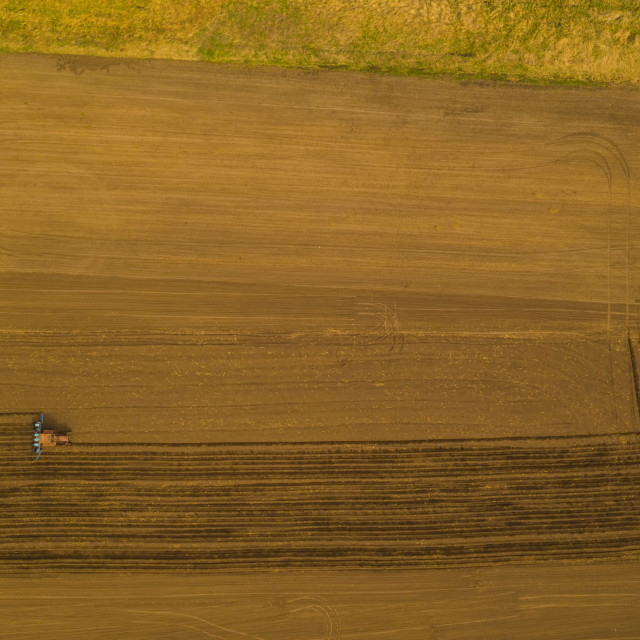 """Aerial view of working traktor"" stock image"