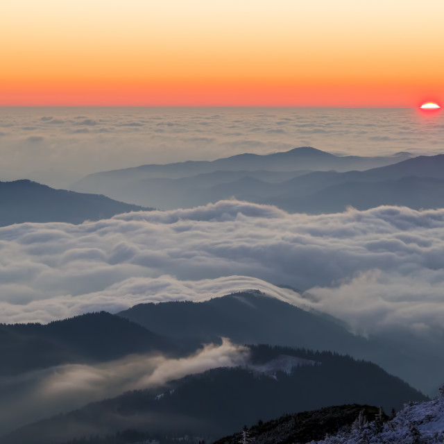 """""""Scene from mountain peak with low clouds"""" stock image"""
