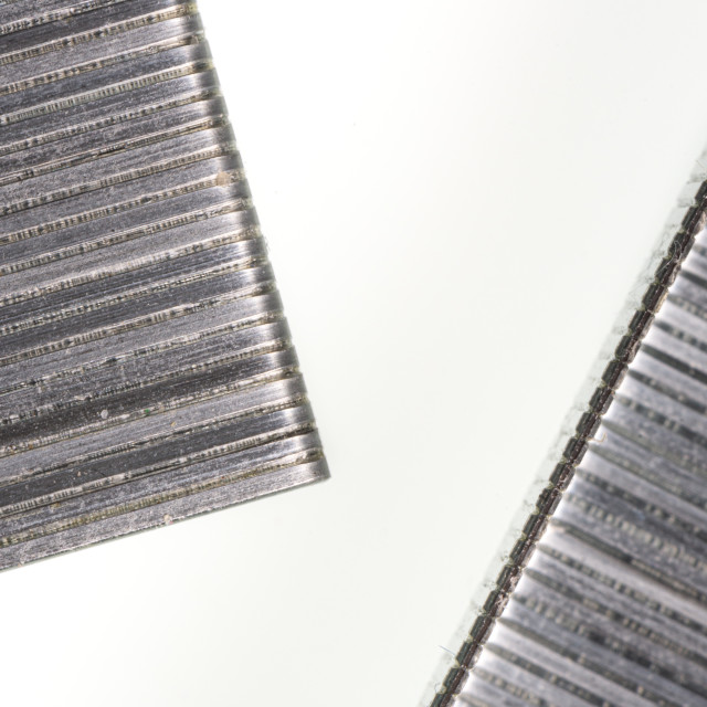 """""""Abstract image composed of two office staples slats"""" stock image"""