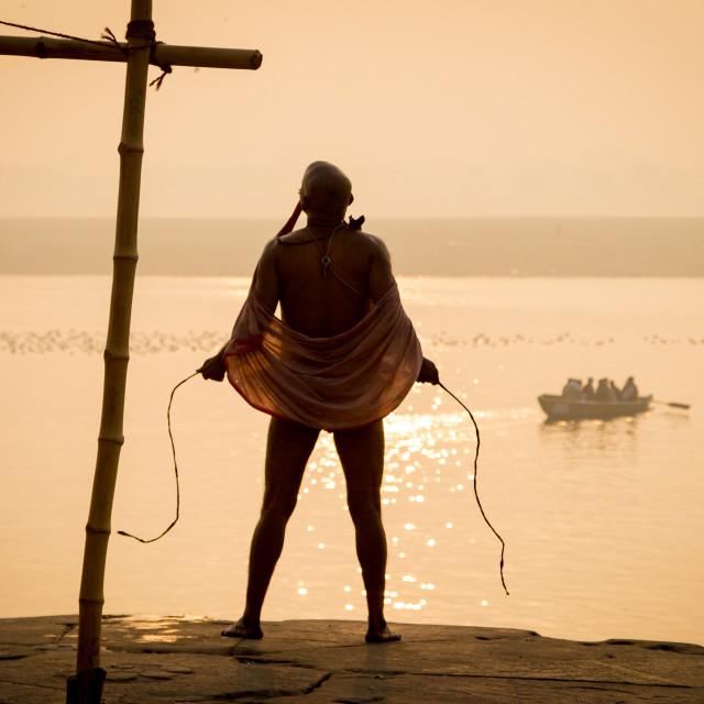 """Dressing at Sunrise on the Ganges"" stock image"