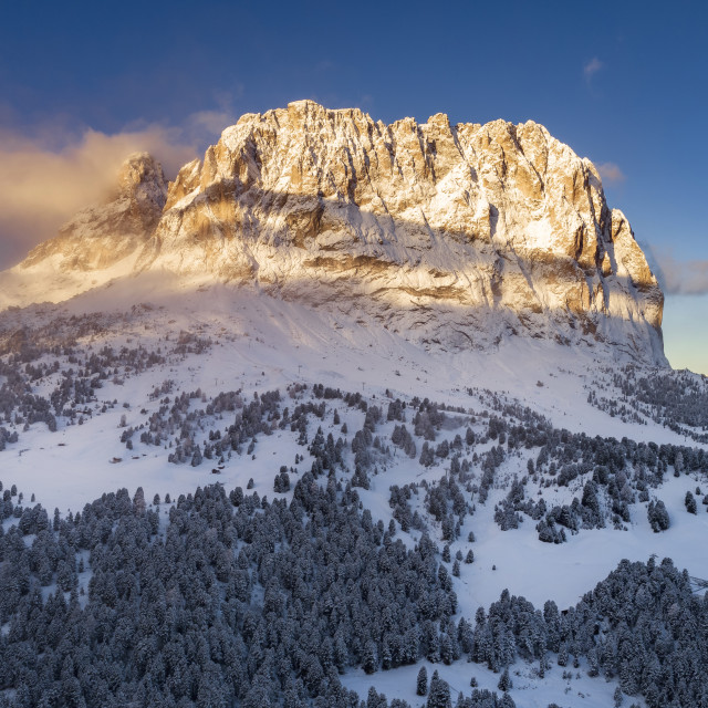 """""""Dolomite peaks in Italy , South Tyrol - Sunrise light during cold winter..."""" stock image"""