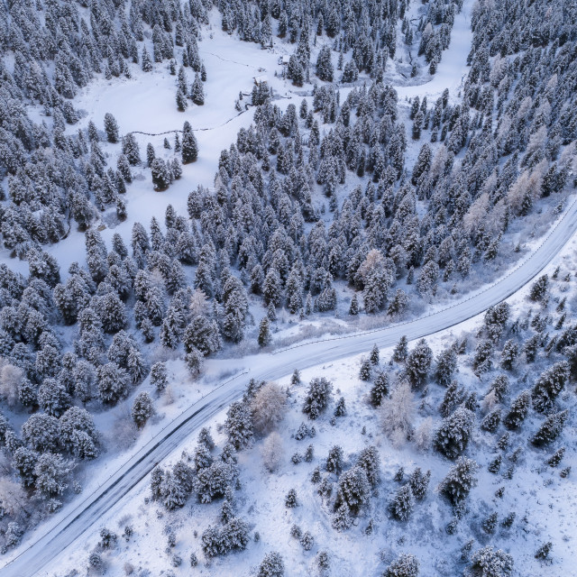 """""""Aerial view of Curved road in the snowy mountains of Italian Alps in South..."""" stock image"""