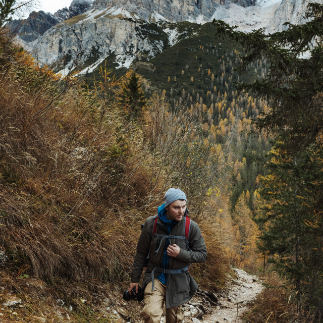 """""""Young male dressed in colourful jacket standing on the ''lago di sorapis''..."""" stock image"""