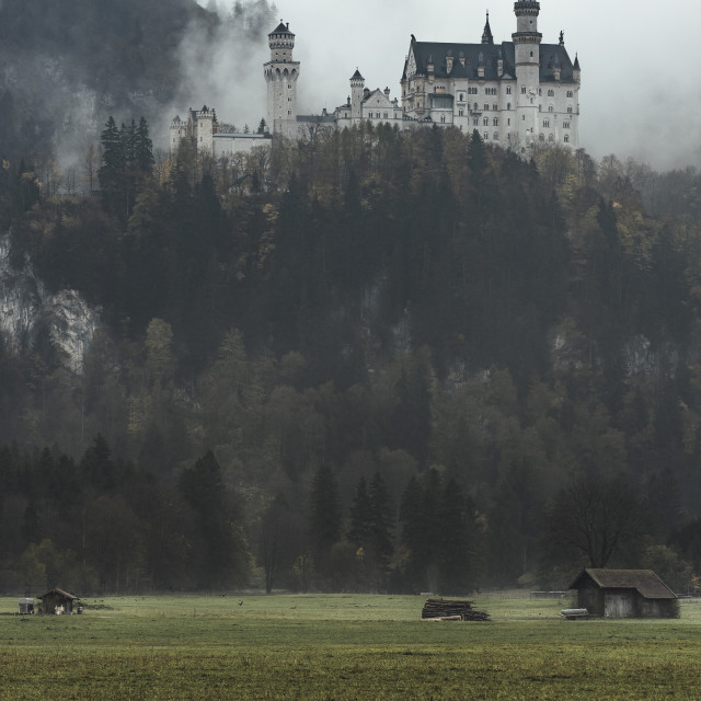 """Neuschwanstein Castle in heavy fog and bright white sky, located in..."" stock image"