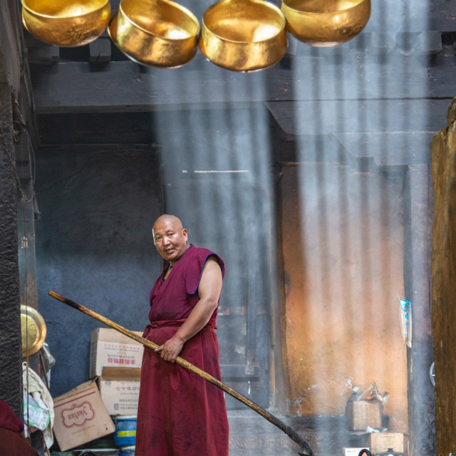 """""""Buddhist Monk in Kitchens"""" stock image"""
