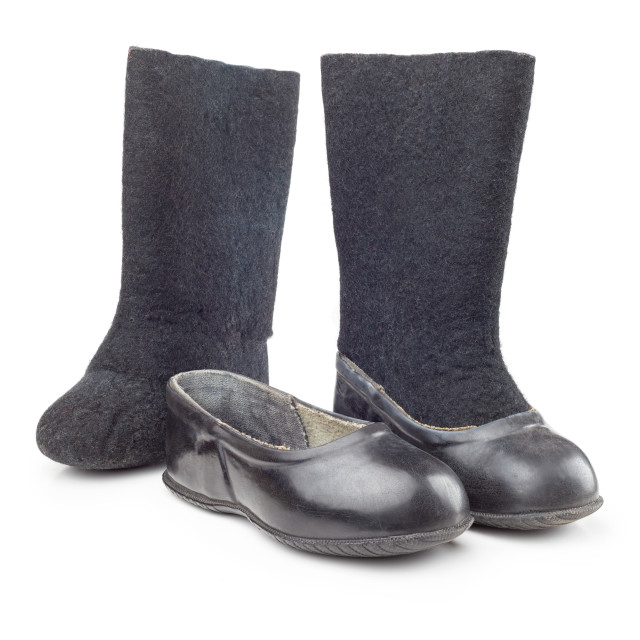 """A pair of black rubber and felt boots and puffs for children"" stock image"