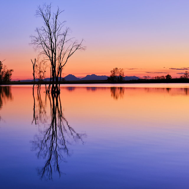 """Amazing Sunset Over A Tranquil Lake"" stock image"