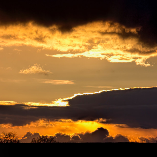 """Fire in the Sky 001. Cotswolds evening. Black & Gold."" stock image"