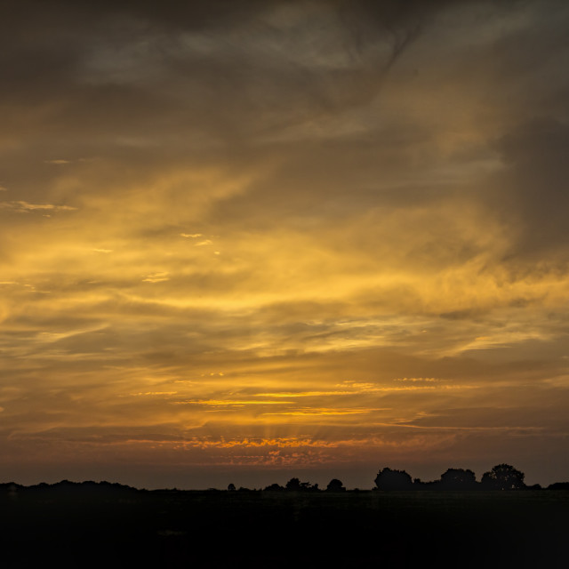 """Fire in the Sky 004. Cotswolds evening. Black & Gold."" stock image"