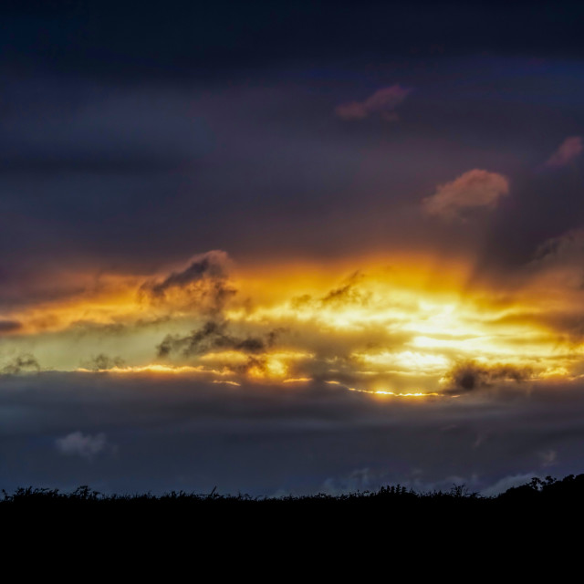 """Fire in the Sky 005. Cotswolds evening. Black & Gold & Blue"" stock image"