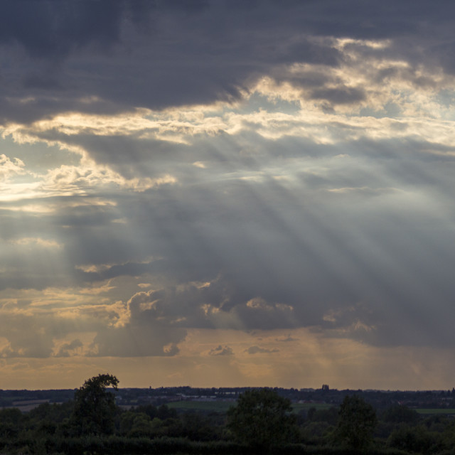 """Sun rays pour down. An evening in the Cotswolds."" stock image"