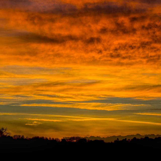 """Fire in the Sky 007. Cotswolds evening. Black & Gold & Blue"" stock image"