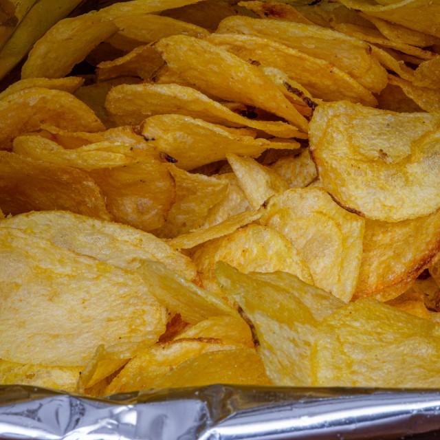 """Chips in aluminum paper bag"" stock image"