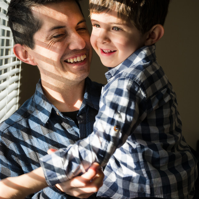 """""""Father and son smiling happily"""" stock image"""