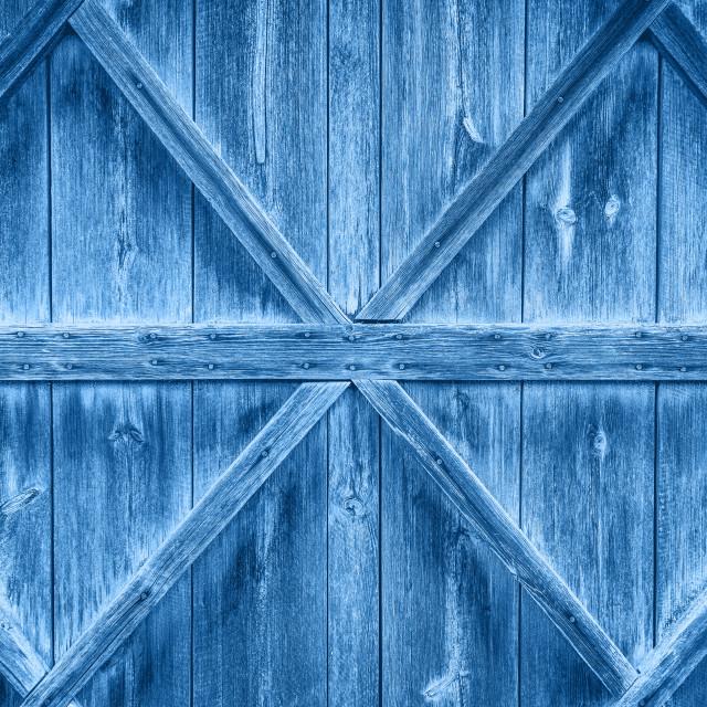 """Old wooden door pantone classic blue color background"" stock image"