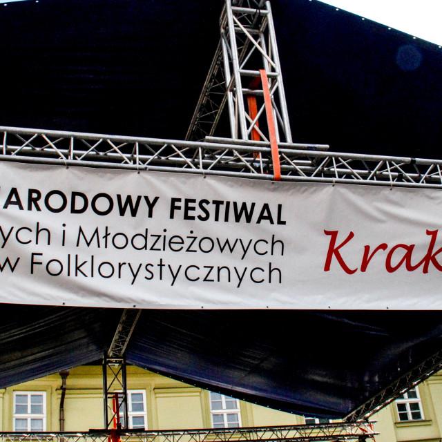 """Sign advertising the International Festival of Children and Youth Folk Groups. Krakow, Poland.2013"" stock image"
