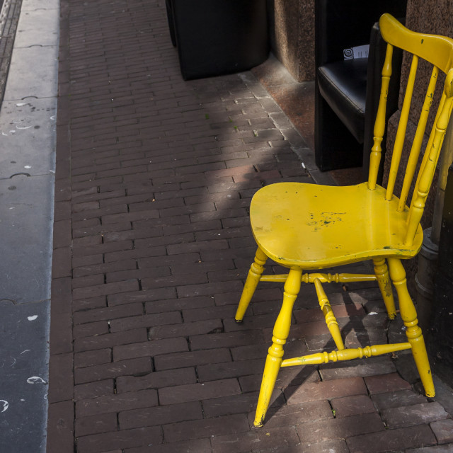 """Empty yellow chair"" stock image"