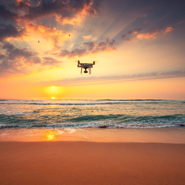 """Beautiful morning over the sea and flying drone"" stock image"