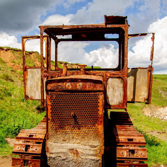 """Derelict Old Rusty Tractor in Field"" stock image"
