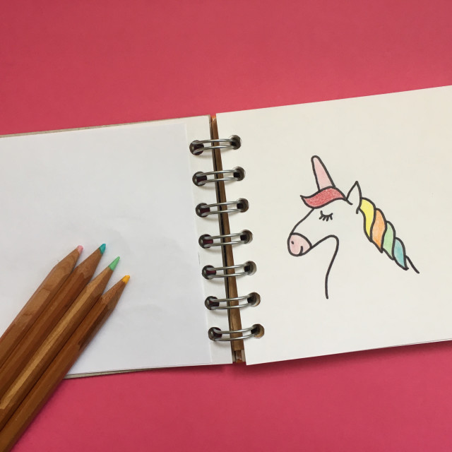 """Simple drawing of a unicorn in a book with crayons"" stock image"