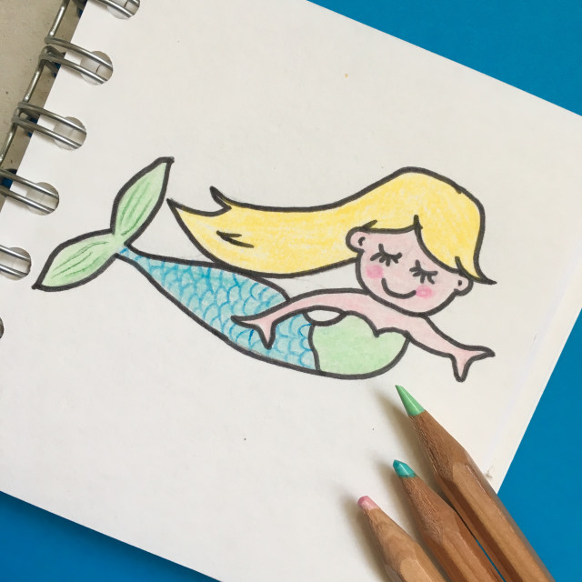 """Simple drawing of a mermaid in a book with crayons"" stock image"