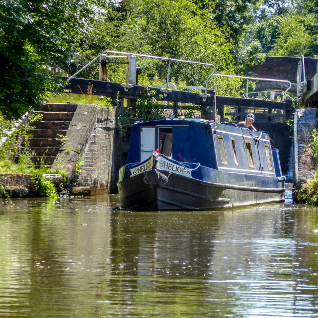"""""""Narrowboat negotiating a lock on the Grand Union Canal"""" stock image"""