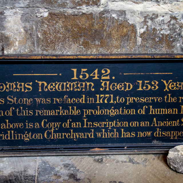 """Priory Church of St Mary, Bridlington. Sign relating to Thomas Newman aged 153 Years."" stock image"