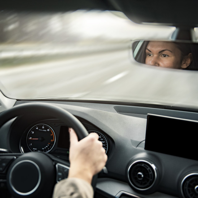 """Young beautiful female driving an automobile on a highway ."" stock image"