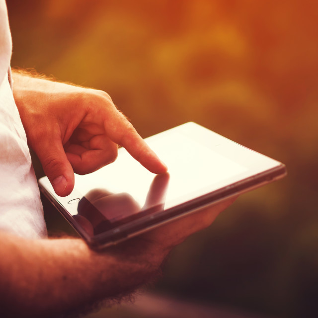 """""""man with digital tablet outdoors"""" stock image"""
