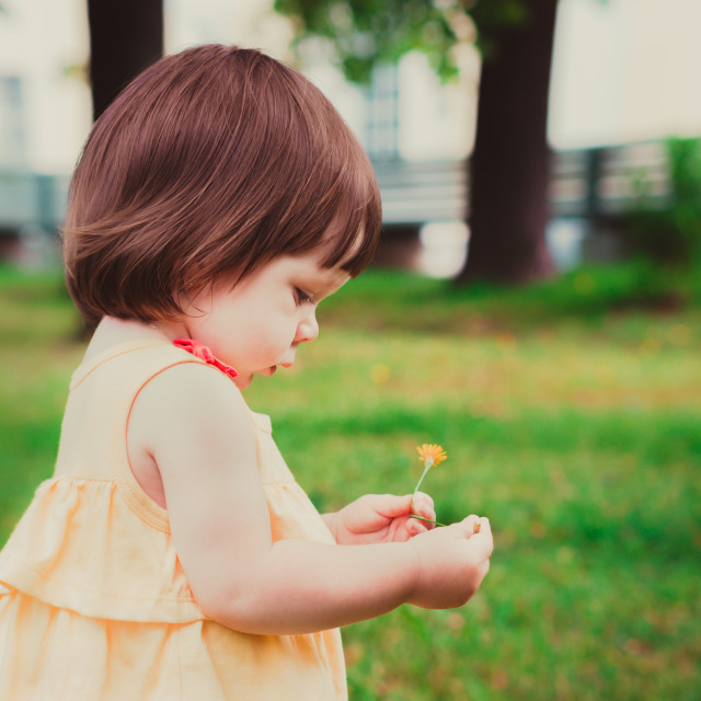 """""""Little Baby Girl Portrait in profile outdoor"""" stock image"""