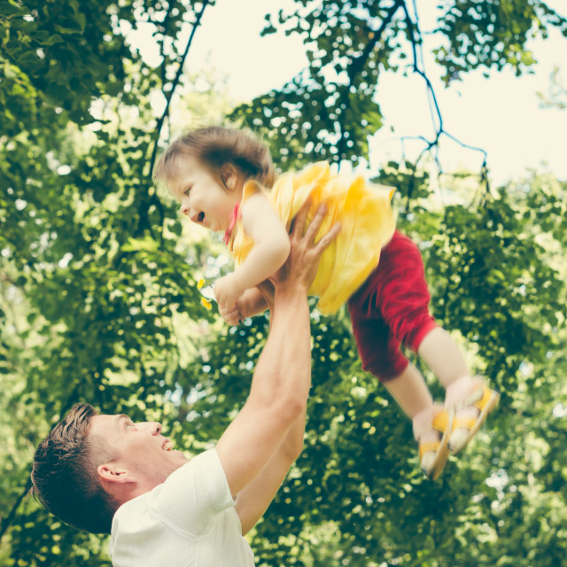 """""""Father throws up his little girl"""" stock image"""