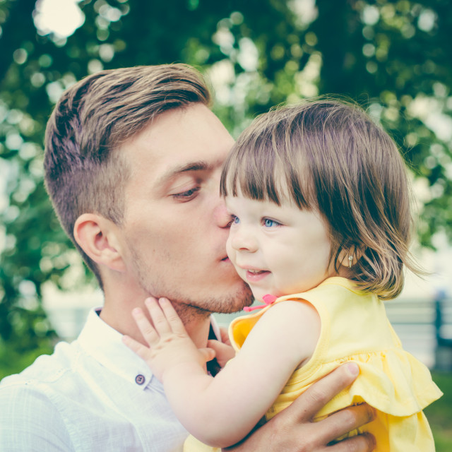 """""""Dad kissing his little daughter"""" stock image"""