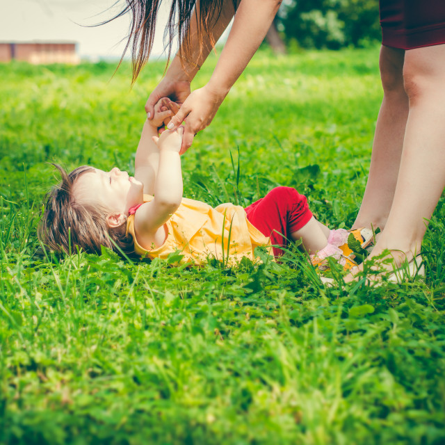 """""""Mother and little daughter playing together"""" stock image"""